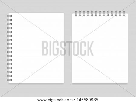 Blank realistic white spiral notebooks vector mockup