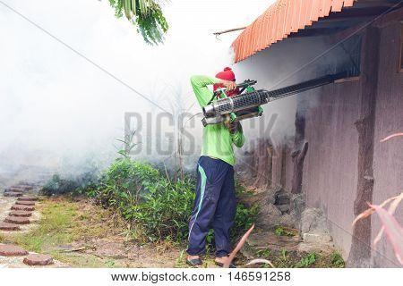 Man Fogging to prevent spread of dengue fever in thailand