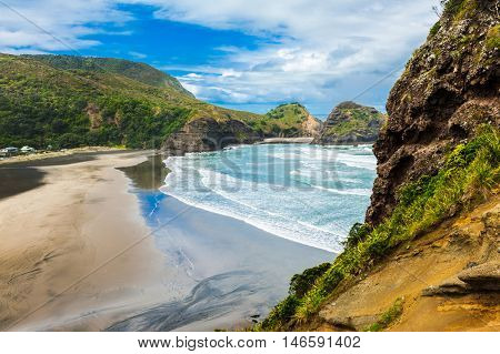 Beautiful Piha beach near Auckland seen from the mighty Lion Rock, New Zealand