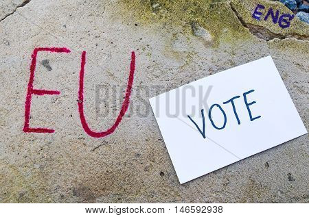 Brexit UK EU referendum concept with word UN and Eng and vote on stone wall