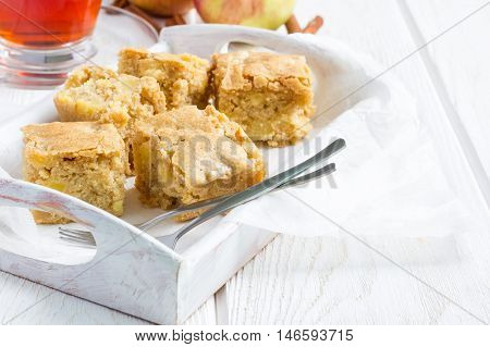 Homemade blondie (blonde) brownies apple cake square slices in wooden tray horizontal copy space