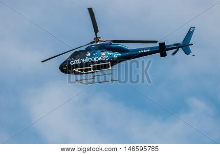 JUNE 18 2011 - BARCELONA SPAIN: Tourist helicopter in barcelona's sky