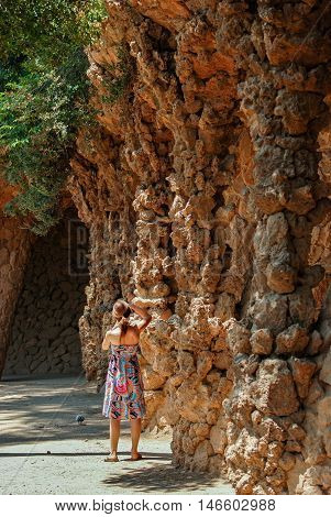 JUNE 16 2011 - BARCELONA SPAIN: Young girl walking at Park Guell. Barcelona