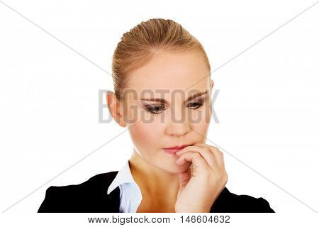 Young  nervous business woman biting her nails