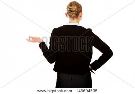 Back view of  business woman shrugging with I dont know gesture