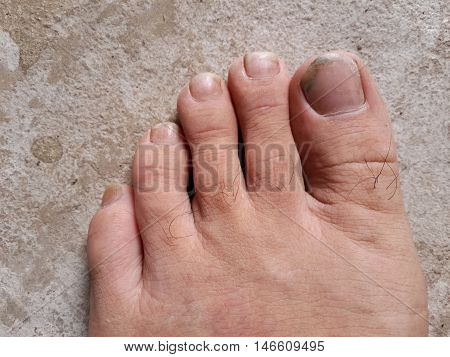 close up man foot on cement floor
