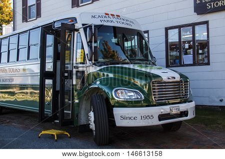 BAR HARBOR, USA - OCTOBER 15, 2015: Bus of the Acadia National Park Bus Tours waiting for passengers the front door of the bus is open