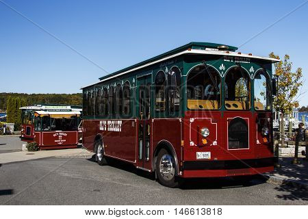 BAR HARBOR, USA - OCTOBER 15, 2015: Red green bus of Oil's Trolley in Bar Harbor (Maine USA) for tours to the Acadia National Park
