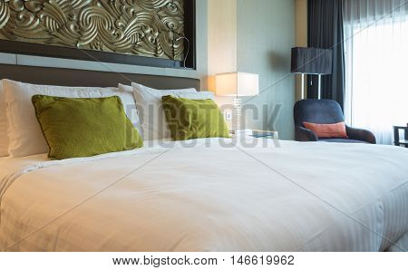 bed sheets and pillows at bedroom in the morning. concept of bedding bedroom.