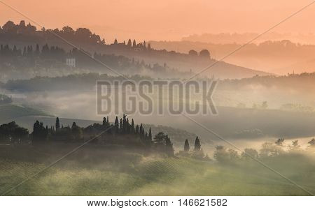 Tuscany Village Landscape On A Misty Morning In July