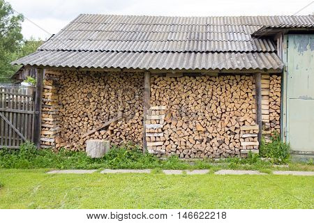 Woodpile near house in a Russian village