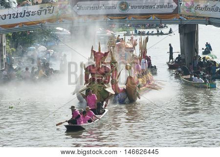 SAMUT PRAKAN , THAILAND - OCTOBER 3, 2009 : Beautiful flower boats in floating parade, the unique annual Rup Bua Festival ( Lotus Throwing Festival ) on end of Buddhist lent in Klong  Bangphli canal, Samut Prakan Province, Thailand.