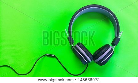 A Earphome on green colur  technology background