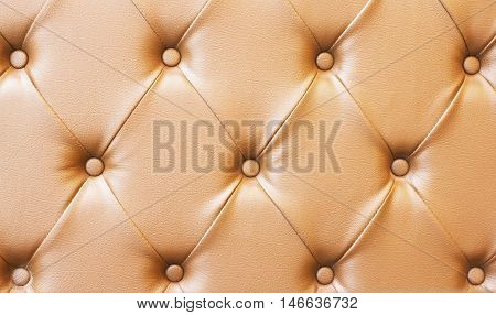 Backboard of color brown chesterfield sofa texture