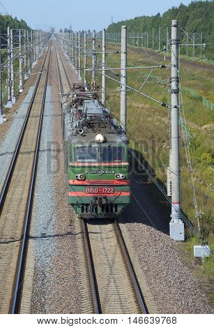 LENINGRAD REGION, RUSSIA - AUGUST 17, 2015: Electric locomotive VL-10 on the double-track section of the railway