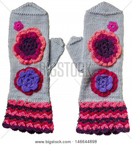 Knitted mittens for adults with pattern from flowers. Knitted mittens for adults with pattern from flowers. Mittens sewing by craftsman and have unique design