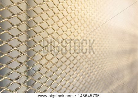 steel wire fence over sunny ligh background