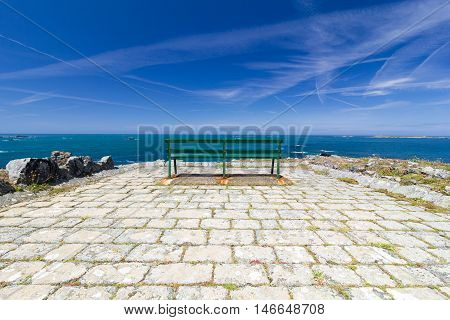 Public seating bench on the coast of Guernsey, Channel Islands.