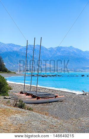 Catamarans On Kaikoura Pebble Beach, New Zealand