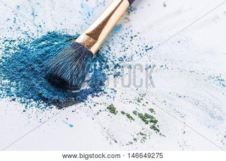 Crisp blue eye shadow with brush on white background