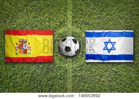 Spain Vs. Israel Flags On Soccer Field, 3D Illustration