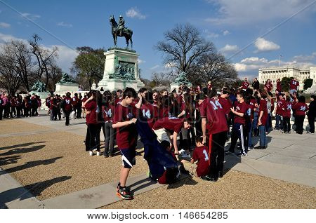 Washington DC: Students on a field trip visiting the Ulysses S. Grant Memorial opposite the Capitol Reflecting Pool on the Mall