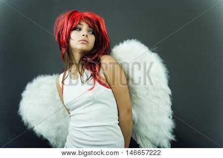 Nervous Redhead With Wings