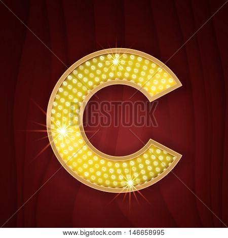 Gold light lamp bulb letter C.