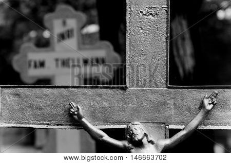 Black and white closeup of Jesus on the cross.