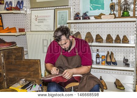 The Shoemaker Opens His Shop At The Annual Bahnhofsviertel Party To Show His Handicraft