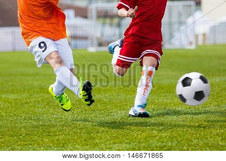 Children kicking football soccer match. Football match for young boys. Training and football soccer tournament