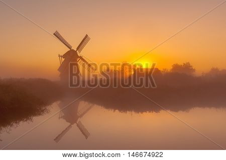 Historic Windmill Along A Canal