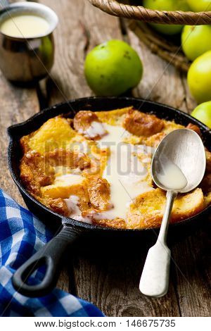 CARAMEL APPLE STRATA in a pig-iron frying pan. style rustic. selective focus