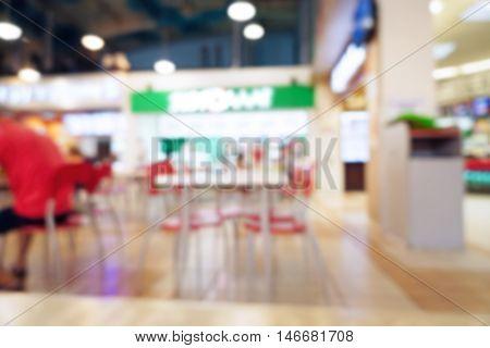 Blurred interior of fast food restaurant