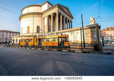 Turin cityscape view on Gran Madre square with church and old yellow tram in the morning