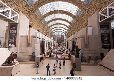 PARIS FRANCE -12 AUG 2016- Visitors at the Musee d'Orsay in Paris. Located in the former Gare d Orsay train station the museum has the largest collection of impressionist paintings in the world.
