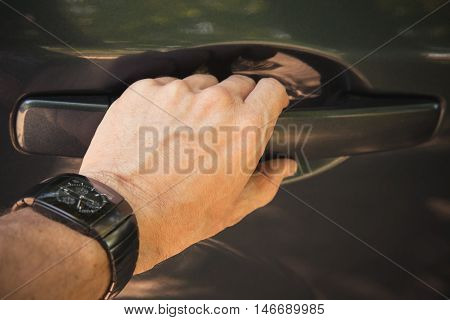 Male Hand With Wirst Watch Opens Car Door