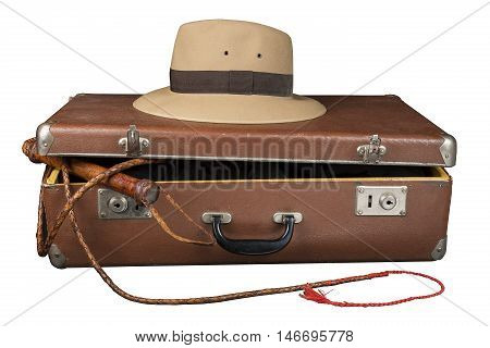 Travel and adventure concept. Vintage brown suitcase with fedora hat and bullwhip isolated on white background.