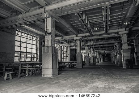 Industrial zone. Black-white photo of abandoned empty industrial building