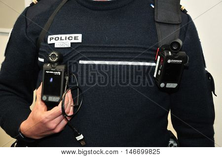 Les Mureaux France - april 8 2016 : close up of a security camera on a policeman uniform