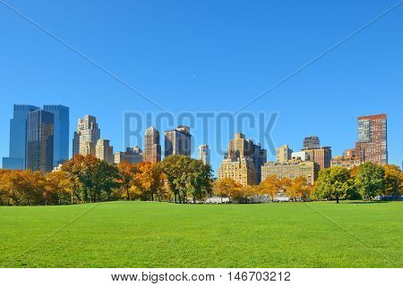 Manhattan midtown skyline viewed from central park in Autumn in New York City.
