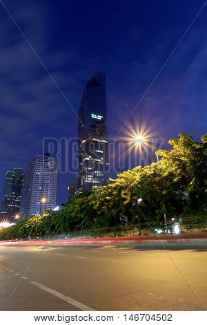 View Silom road in twilight of Mahanakhon buildingThis is the new highest of building in Bangkok at Thailand.