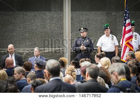 NEW YORK - SEPT 9 2016: Dignitaries at the NYC Police Memorial at the NYPD Emerald Society Pipe and Drums 9/11 Memorial Commemoration Service marking the 15th anniversary of the terror attacks.