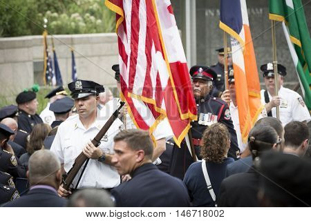 NEW YORK - SEPT 9 2016: The police Honor Guard present colors at the NYPD Emerald Society Pipe and Drums 9/11 Memorial Commemoration Service marking the 15th anniversary of the terror attacks.