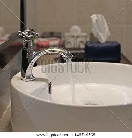 Ceramic Washbasin And Metal Faucet