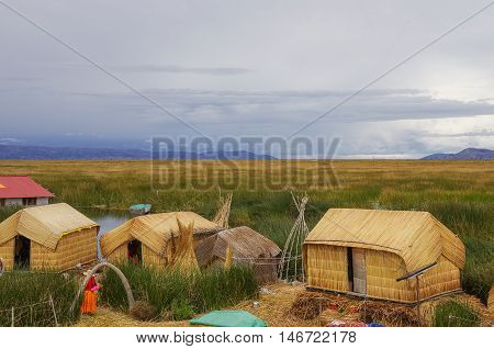 Titicaca, Peru- January 4, 2015 - Traditional houses of local people in Uros islands on Lake Titicaca.