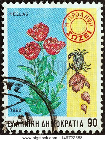 "GREECE - CIRCA 1992: A stamp printed in Greece from the ""Health"" issue shows Crab killing flower on healthy plant (anti-cancer campaign), circa 1992."