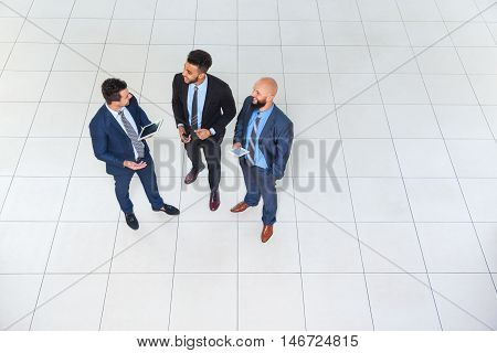 Business Man Group Discussion Meeting, Three Businessman Talking Hold Tablet Computer, Businesspeople Colleague Team Top Angle View