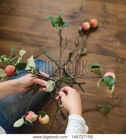 Florist makes basis for bouquet of apple branches