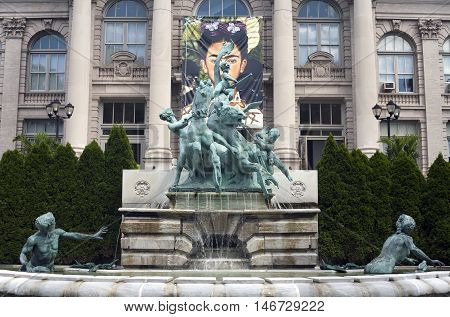 BRONX NEW YORK - AUGUST 19: Lillian Goldman fountain of life in front of LuEsther T. Mertz library at the botanical garden. Taken August 19 2015 in New York.